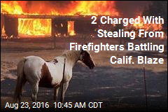2 Charged With Stealing From Firefighters Battling Calif. Blaze