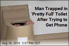 Man Follows Dropped Phone Into Toilet, Gets Stuck
