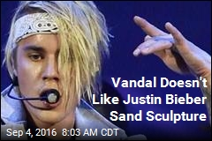 Vandal Doesn't Like Justin Bieber Sand Sculpture