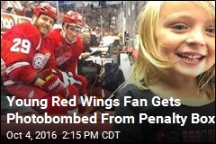 Young Red Wings Fan Gets Photobombed From Penalty Box