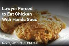Lawyer Forced to Eat Chicken With Hands Sues
