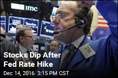 Stocks Dip After Fed Rate Hike