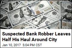 Suspected Bank Robber Leaves Half His Haul Around City