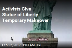 'Refugees Welcome' Banner Draped on Statue of Liberty