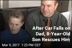After Car Falls on Dad, 8-Year-Old Son Rescues Him
