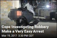 Cops Nab Robbery Suspect Stuck in Window