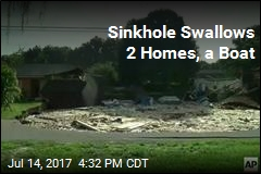 Sinkhole Swallows 2 Homes, a Boat