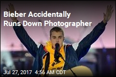 Bieber Accidentally Drives Into Photographer