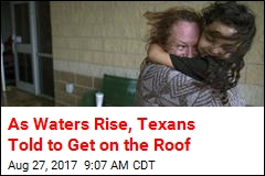 As Waters Rise, Texans Told to Get on the Roof