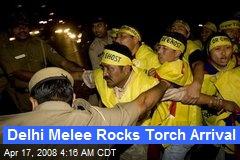 Delhi Melee Rocks Torch Arrival