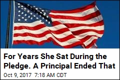 Suit: Teen Booted From School for Not Standing During Pledge