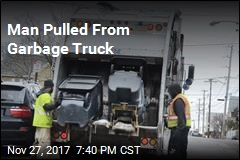 Fighterfighters Rescue Man From Garbage Truck