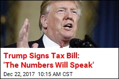 Trump Signs Tax Overhaul Into Law