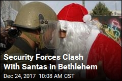 Security Forces Clash With Santas in Bethlehem