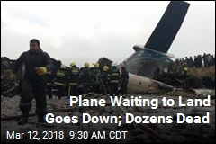 Plane Waiting to Land Goes Down; Dozens Dead