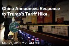 China Threatens Tariffs on US Pork, Wine, Apples