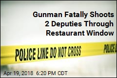 Gunman Fatally Shoots 2 Deputies Through Restaurant Window