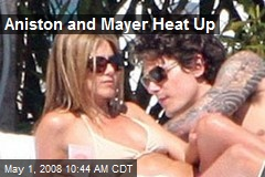 Aniston and Mayer Heat Up