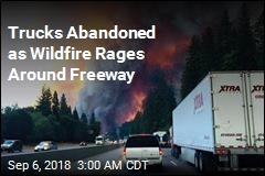 Trucks Abandoned as Wildfire Rages Around Freeway
