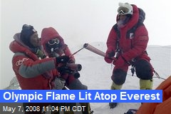 Olympic Flame Lit Atop Everest