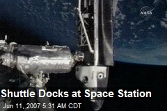 Shuttle Docks at Space Station