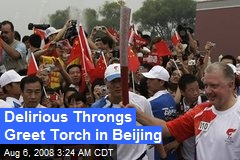 Delirious Throngs Greet Torch in Beijing