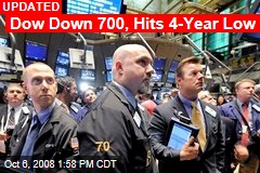 Dow Down 700, Hits 4-Year Low