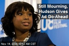 Still Mourning, Hudson Gives Ad Go-Ahead