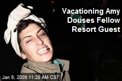Vacationing Amy Douses Fellow Resort Guest