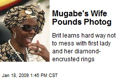 Mugabe's Wife Pounds Photog