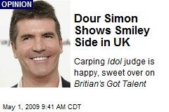 Dour Simon Shows Smiley Side in UK