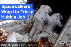 Spacewalkers Wrap Up Tricky Hubble Job
