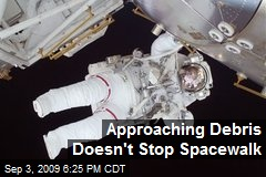 Approaching Debris Doesn't Stop Spacewalk