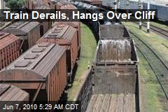 Train Derails, Hangs Over Cliff