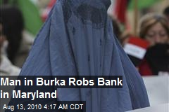 Man In Burqa Robs Bank