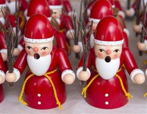 Traditional wooden incense smoker Santa Claus figures, so-called 'Raeuchermann', are displayed at a company in the Erzgebirge mountain region in Gahlenz, eastern Germany, Monday, Dec. 7, 2015.